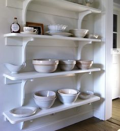 love this wall of shelves - I am totally doing this!