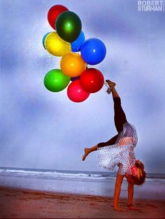 Kathryn Budig: The Yoga of Balloons by the Carousel. ~ Photographed by Robert Sturman
