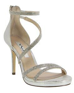 4090bbfb93cb This crystal-encrusted strappy dress sandal offers a polished look with a  mini platform for a bit of edge. Pair it with your favorite little black  dress for ...