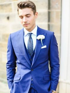 Nice suit. Not crazy about the purple, but the styling of the ...
