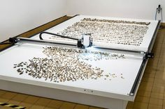 A Kinetic Artwork that Sorts Thousands of Random River Stones by Age | Colossal | Performing the role of a scientist, Benjamin Maus and Prokop Bartonicek's kinetic machine Jller selects and sorts pebbles found on a 6 1/2 x 13 foot platform into a grid organized by geologic age.