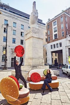 Job Smeets and Nynke tynagel of studio job serve their  new fast-food furniture for seletti right in the middle  of milan's piazza affari.
