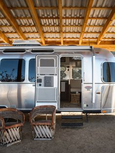This is perfect for my desert house. Build a big corrugated metal carport. Then pull the airstream into it for a cozy trailer winter. Ooh and add a fire pit. Airstream Bambi, Airstream Camping, Airstream Interior, Vintage Airstream, Airstream Trailers, Vintage Caravans, Vintage Travel Trailers, Airstream Living, Glamping