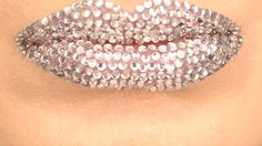 Add some sparkle to your smile with this gorgeous, rhinestone studded lip look!