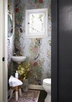floral patterned wallpaper in the powder room
