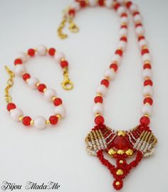Seductive macrame set with red and cream glass beads, crystals and golden beads, specially made for your special occasions with a lot of love and care of the detail.  Central part of the necklace is taken of a passionate red crystal with diameter of 12 mm. Red crystals bring you energy, courage, passion and love. Red is the color of passion, energy, and life. It is a very strong color—the color of fire and blood. Red is a call to action, a battle cry and a sign of warning. It excites us…