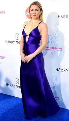 Kate Hudson in a plunging purple satin dress