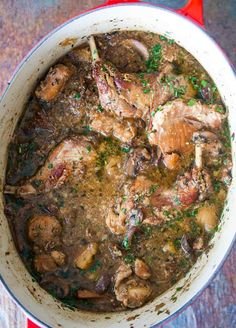 Rabbit Stew with Mushrooms - Hearty rabbit stew with fresh and dried mushrooms, parsnips, garlic, shallots, and sherry. Rabbit Dishes, Rabbit Food, Dried Mushrooms, Stuffed Mushrooms, Gluten Free Wine, My Burger, Burgers, Wild Game Recipes, Roasted Garlic