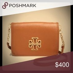 "Tory Burch Britten combo crossbody handbag bark Gilded logo hardware sets a polished tone for Tory Burch's classic foldover crossbody. The convertible design adds mileage to your workweek style: Just remove the optional strap to carry it as a clutch after office hours. Leather; lining: logo-print polyester Imported Detachable adjustable crossbody strap Magnetic flap closure Two interior zip pockets, two interior slip pockets, interior cell phone pocket Full logo lining 8""L x 3""W x 6""H; 24""…"