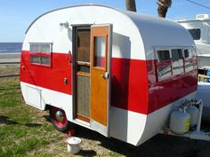 This one suits me fine!  It's from the early 1950s...a classic. Adorable.  All it needs is me, and a cat and a dog and the Man. #Glamping #Camping #Trailers #Campers