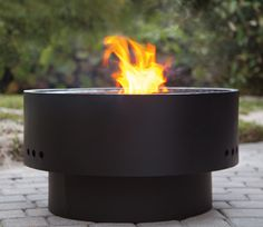 Add some friends, marshmallows and a cool, summer night. The HotSpot Solid Base Revolver Fire Pit with Wooden Top.