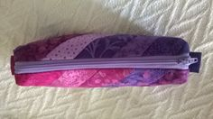I like the different colour stripes on this pencil case and I think the colours are very cute and pretty.