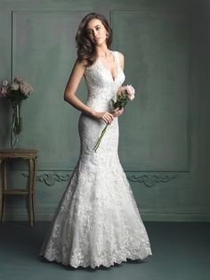 This lace gown features contour straps and gorgeous Swarovski crystal beading at the neckline.