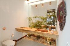 Um jeito bacana de inserir o paisagismo em banheiros e lavabos