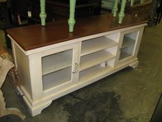Old dresser, remover drawers, drill holes in back for cables & use for tv/media. Add baskets for storage?
