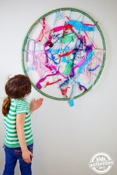 Make this fun weaving craft from a bent hula hoop!