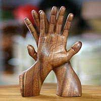 Discover unique handcrafted treasures. Every purchase will help UNICEF save and improve children's lives and help support talented artisans. Wood statuette, 'Hand of Friendship'