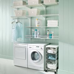 clean light blue & white laundry room! small space but lots of great shelving/storage