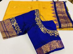 Yellow and Blue Gadwal Saree Add a charm to your look in this yellow gadwal saree with gold buttas all over paired with broad blue border and pallu complemented by blue embroidered blouse. Saree includes pico and fall. Cutwork Blouse Designs, Wedding Saree Blouse Designs, Pattu Saree Blouse Designs, Fancy Blouse Designs, Blouse Patterns, Wedding Sarees, Embroidered Blouse, Bollywood Saree, Bollywood Fashion