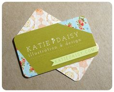 This business card from Katie Daisy Illustrations and Design is one of my favorites. I love the contrast in colors as well as the contrast between the plain green the the floral design on the corners.