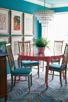 another pinner writes: i love everything about this space: the low-hanging placement of the framed wallpaper swatches, the golden chairs, the fern centerpiece, the chandelier, the deep turquoise walls, the contrasting coral table, the flamestitch FLOR tile, and the sky blue ceiling overhead