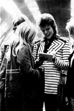Bowie signing autographs for fans - Victoria Station 1973