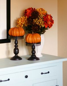 Love the use of candle sticks with pumpkins on top!