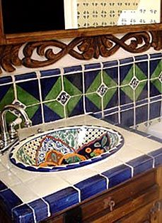 Patterned sink with solid, light-colored countertop looks nice.