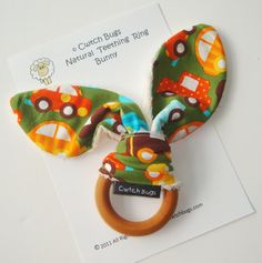 Natural Wooden Teething Ring 'BUNNY' in ORGANIC 'Cars'  fabric ....A  Gift idea from Cwtch Bugs. £8.00, via Etsy.