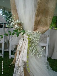 Could combine burlap and tulle for a backdrop & add in any color with flowers
