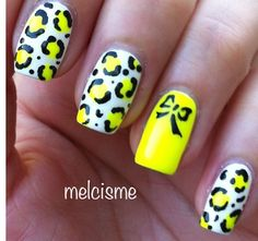 White & yellow cheetah with yellow nail with bow