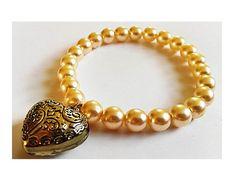 Cream Bead And Bronze Heart Pendant Stretch Bracelet  by Euphena