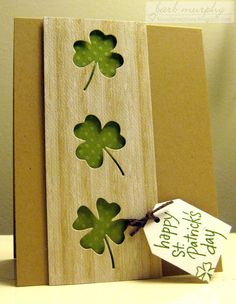 handmade St. Patrick's Day card from kinsale creations ... negative cut shamrocks on a panel ... kraft base ... would look great in white too ...