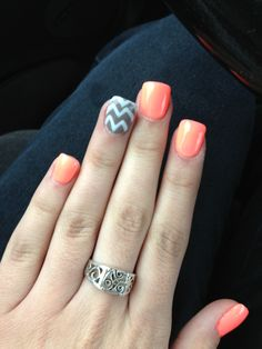 Coral and grey chevron nails. Just got them done and love them :)