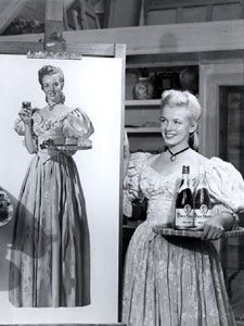 Marilyn Monroe poses with the wine dolly in1947