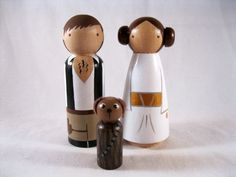 Princess Leia Han Solo and Chewie Dog Wood Peg Doll Cake Toppers. $65.00, via Etsy.
