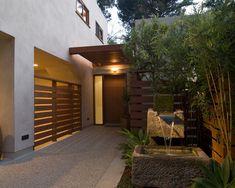 contemporary home exterior design garden fountain stone basin wooden fence bamboo trees