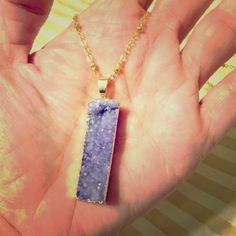NEW✨ Amethyst Necklace Stunning Amethyst Druzy  pendant necklace. Breathtaking geode rectangle bar. Gold dipped and looks amazing with any outfit. Suspended on a decorative 24 inch gold plated satellite chain. Measures approximately 1 3/4 inch! Must have for summer. ❤️Please Bundle to save extra on shipping❤️PRICE IS FIRM❤️ Jewelry Necklaces