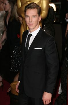 Benedict Cumberbatch arrives on the red carpet for the 86th Academy Awards on March 2nd, 2014 in Hollywood, California