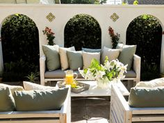 Great idea for a small backyard. Build a fake wall and cover fence with greenery. Intimar=te seating area and voila. You could even build in some poles for a shade sail. Fantastic. SOURCE: Your Backyard Design Style Finder : Outdoors : HGTV