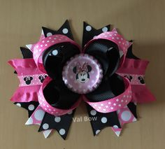 A personal favorite from my Etsy shop https://www.etsy.com/listing/253760715/minnie-mouse-hair-bow-minnie-mouse