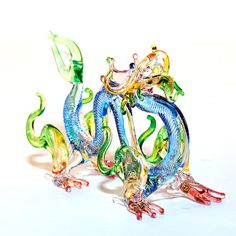Glass Animal Figurine: a handmade magical dragon figurine.  Lampworked boro glass collectible. Blue Color