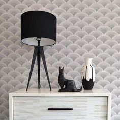 The most stylish scene this side of Salem. Put a chic spin on #Halloween with bewitching accents in black and gray hues. 📷: Color Theory Boston #creepchic #blackcat #home #decor #LinkInProfile