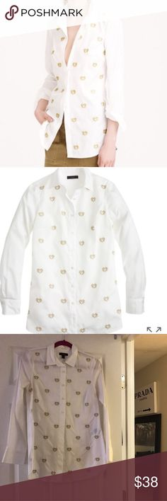 J. Crew Bullion Hearts shirt ❤️ A crisp white shirt gets a little extra love with hand-embroidered gold bullion hearts. Cotton. Long roll-up sleeves. excellent user condition recently dry cleaned and ready for a new home. Size 6 but in my opinion runs large. Length is 30 inch. Looks great layered. 15.5 inch bust for reference.  Item B0636.   🚫Absolutely NO TRADES no exceptions🚫 J. Crew Tops Button Down Shirts