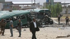Taliban bombers attack an Afghan police convoy outside Kabul, killing at least 30 people and wounding 50 others, officials say.