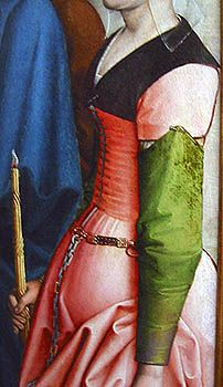 From an unknown flemish painting,  late15th century, Brussels,  Musées Royaux des Beaux Arts    The skirt is attached, and solid in front - but split near the top