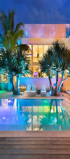 This home in Key Biscayne, FL, features multi-color lighting in conjunction with ultra modern style.