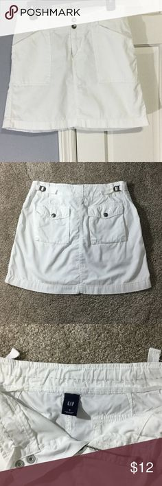 Gap white size 4 summer skirt Adorable white GAP skirt size 4.  Perfect condition cotton with cute details and cute draw string on inside if you want to pull the waist in.  Looks great with cute sandals or flip flops. GAP Skirts