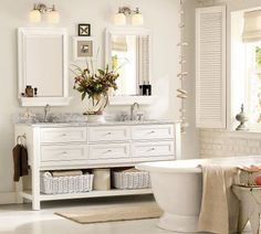 The freestanding wood cabinet gives this bathroom a warmer, cozier look than standard bathroom cabinets would.