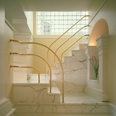 Deco your home with white marble, and rounded, gold handrails.  #80s
